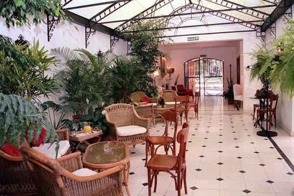 Paquetes tur sticos en el hist rico hotel solar de la for Jardin de invierno loi suites